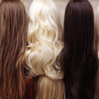 Set of various color wigs as background